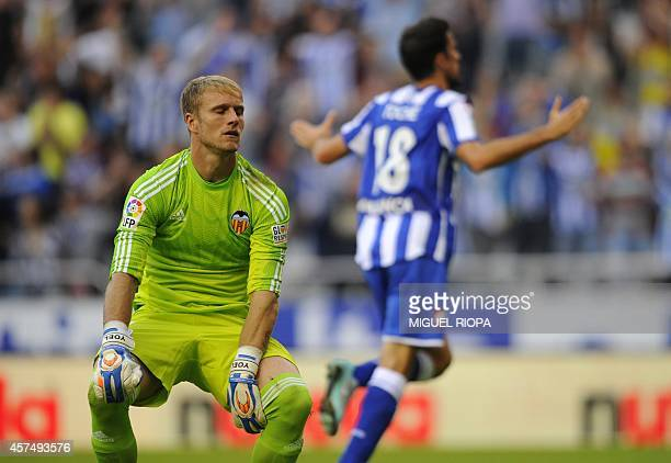Valencia's goalkeeper Yoel Rodriguez reacts as Deportivo's forward Toche celebrates a goal during the Spanish league football match RC Deportivo de...