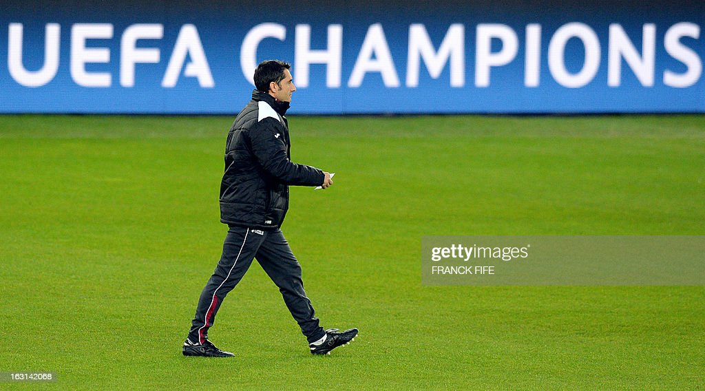 Valencia's head coach Ernesto Valverde attends a training session at the Parc des Princes stadium in Paris, on the eve of their second leg of the UEFA Champions League last 16 match against Paris.