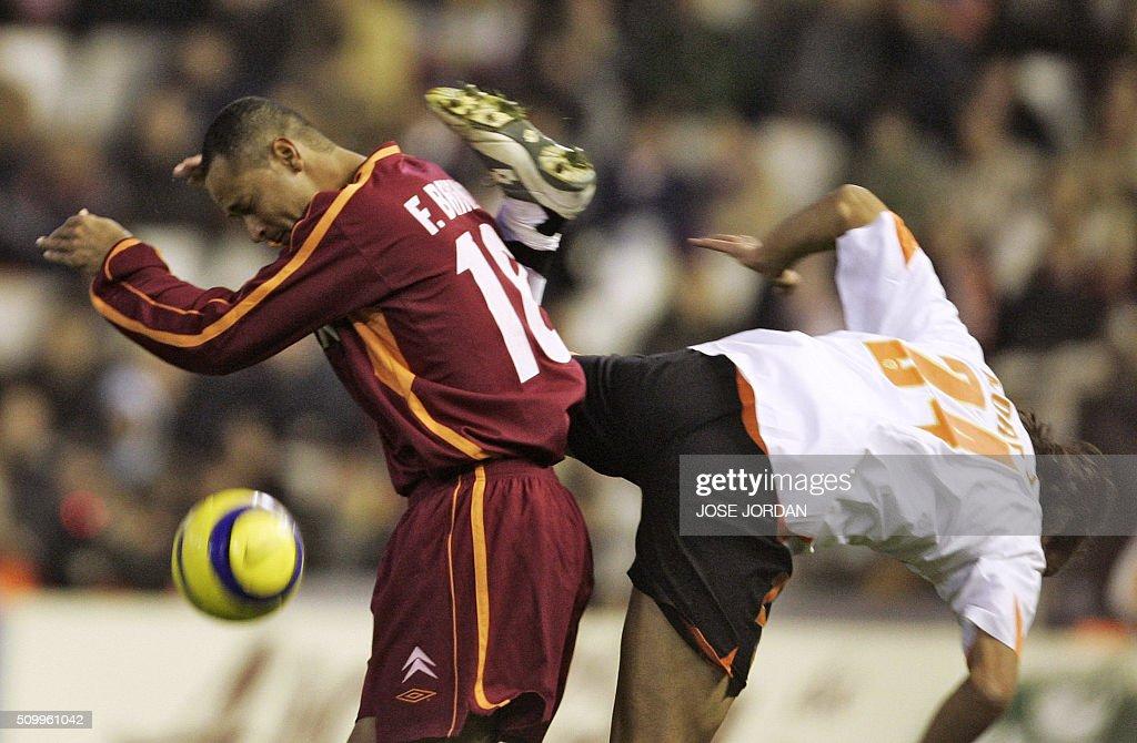 Valencia's Italian Emiliano Moretti fights for the ball with Celta's Brazilian Joao Baiano 26 November 2005 during their Spanish League match at...