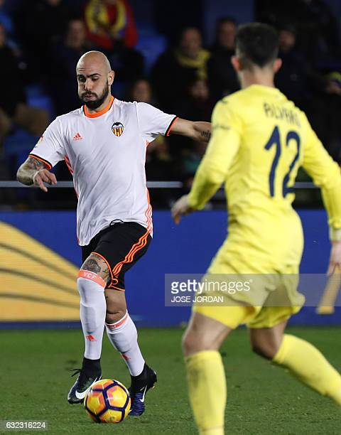Valencia's Italian forward Simone Zaza drives the ball during the Spanish League football match Villarreal CF vs Valencia CF at El Madrigal stadium...