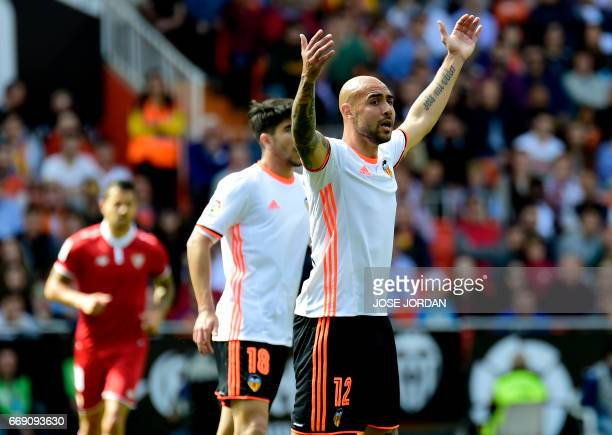 Valencia's Italian forward Simone Zaza gestures during the Spanish league football match Valencia FC vs Sevilla FC at Mestalla stadium in Valencia on...