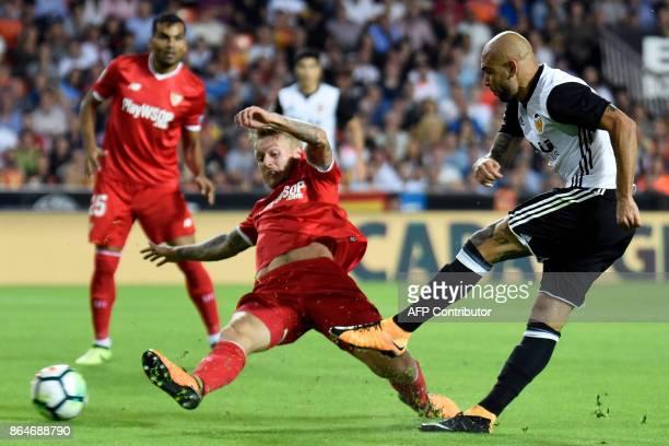 Valencia's Italian forward Simone Zaza kicks the ball to score a goal during the Spanish league football match Valencia CF vs Sevilla FC at the...