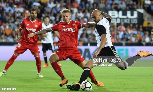 Valencia's Italian forward Simone Zaza prepares to kick the ball to score a goal during the Spanish league football match Valencia CF vs Sevilla FC...