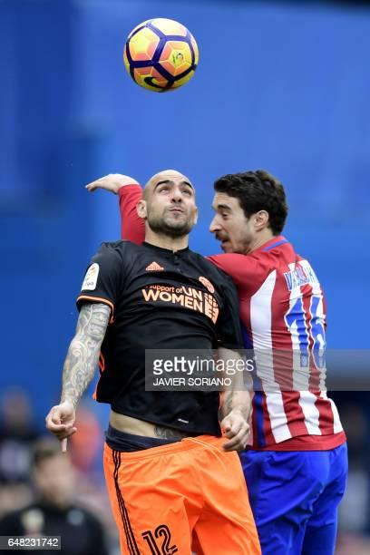 Valencia's Italian forward Simone Zaza vies with Atletico Madrid's Croatian defender Sime Vrsaljko during the Spanish league football match Club...