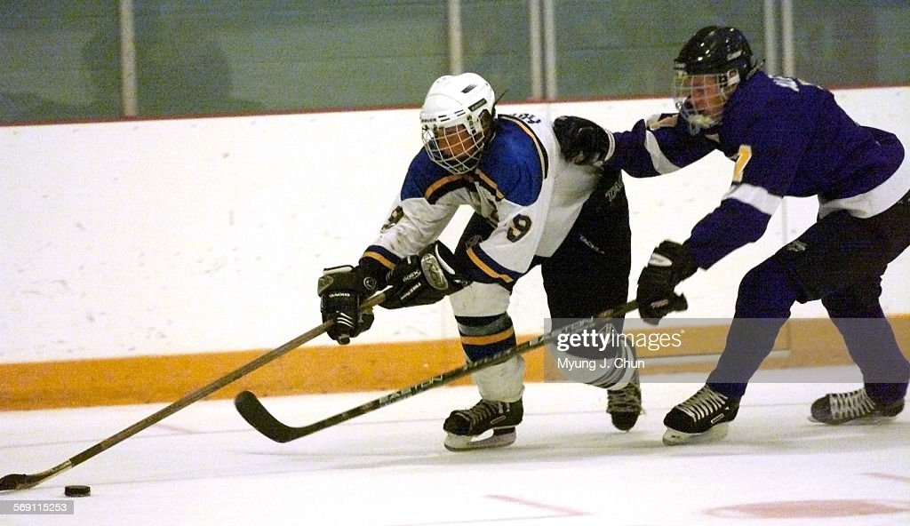 Valencia's Josh Albrent tries to slow down Saugus' Joey Howard during Monday night's game at the Ice Station in Valencia DIGITAL IMAGE SHOT ON MONDAY...