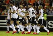 Valencia's midfielder Javi Fuego celebrates his goal with teammates during the Spanish league football match Valencia CF vs Granada FC at the...