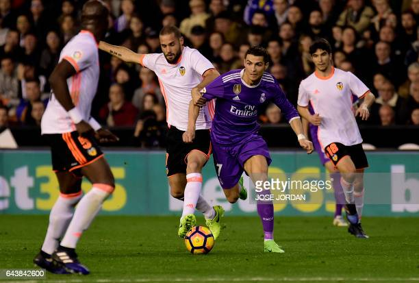 Valencia's midfielder Mario Suarez vies with Real Madrid's Portuguese forward Cristiano Ronaldo during the Spanish league football match Valencia CF...