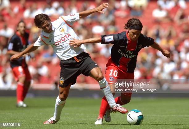 Valencia's Miguel Angulo and Paris SaintGermain's Marcelo Gallardo battle for the ball