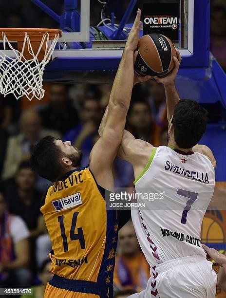 Valencia's Montenegrin center Bojan Dubljevic vies with Laboral Kutxa's Georgian forward Tornike Shengelia during the Euroleague group D basketball...