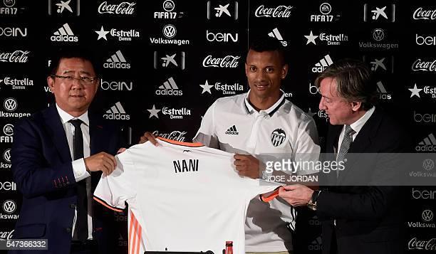 Valencia's new player Portuguese Luis Carlos Almeida de Cunha ' Nani ' and Valencia's Manager Kim Koh and Valencia´s Secretary Garcia Pitarch hold...