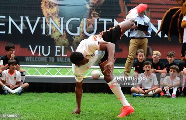 Valencia's new player Portuguese Luis Carlos Almeida de Cunha ' Nani ' dances capodeira during his Official presentation in Valencia on July 142016 /...