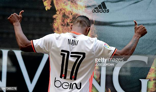 TOPSHOT Valencia's new player Portuguese Luis Carlos Almeida de Cunha ' Nani ' poses during his Official presentation in Valencia on July 142016 /...