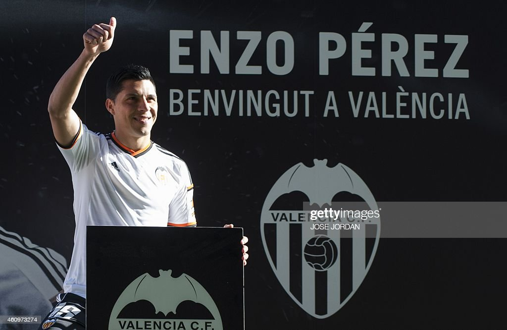 Valencia's new signing Argentinian midfieler <a gi-track='captionPersonalityLinkClicked' href=/galleries/search?phrase=Enzo+Perez&family=editorial&specificpeople=3275855 ng-click='$event.stopPropagation()'>Enzo Perez</a> gestures during his official presentation at the Mestalla stadium in Valencia on January 02,2015.