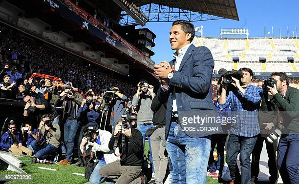 Valencia's new signing Argentinian midfieler Enzo Perez poses during his official presentation at the Mestalla stadium in Valencia on January 022015...
