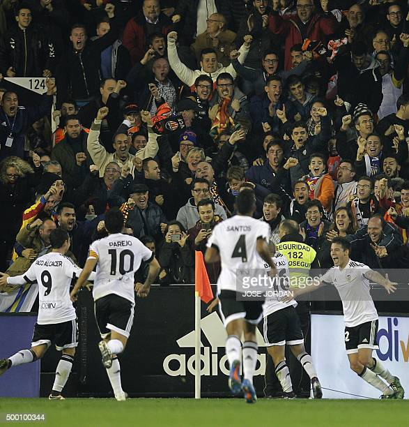 Valencia's players celebrate a goal during the Spanish league football match Valencia CF vs FC Barcelona at the Mestalla stadium in Valencia on...