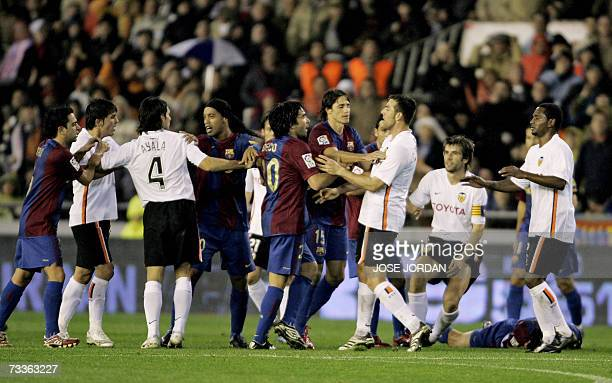 Valencias players fights with Barcelonas players during their Spanish league football match at Mestalla Stadium in Valencia 18 February 2007 Valencia...