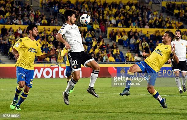 Valencia's Portuguese midfielder Andre Gomes vies with Las Palmas' defender David Garcia during the Spanish Copa del Rey football match UD Las Palmas...