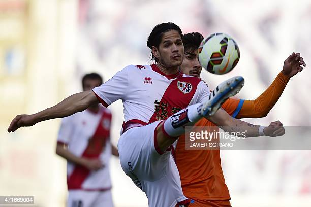 Valencia's Portuguese midfielder Andre Gomes vies with Rayo Vallecano's Portuguese defender Ze Castro during the Spanish league football match Rayo...