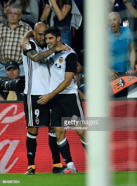 Valencia's Portuguese midfielder Manuel Guedes celebrates with Valencia's Italian forward Simone Zaza after scoring a goal during the Spanish league...