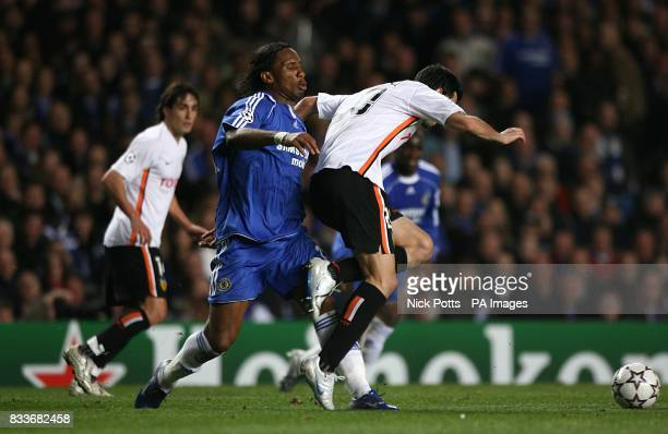 Valencia's Raul Albiol and Chelsea's Didier Drogba battle for the ball