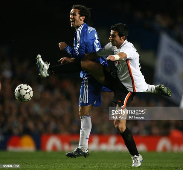 Valencia's Raul Albiol and Chelsea's Ricardo Carvalho battle for the ball