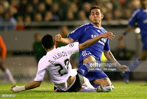 Valencia's Raul Albiol is injured in a challenge with Chelsea's Frank Lampard