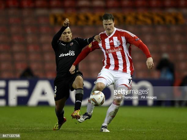 Valencia's Sofiane Feghouli and Stoke City's Robert Huth battle for the ball