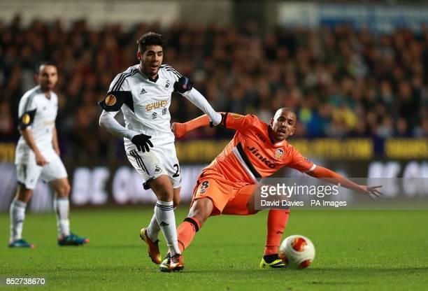Valencia's Sofiane Feghouli and Swansea City's Alejandro Pozuelo battle for the ball