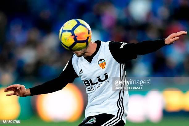TOPSHOT Valencia's Spanish defender Jose Luis Gaya Pena controls the ball during the Spanish league football match Getafe CF vs Valencia CF at the...