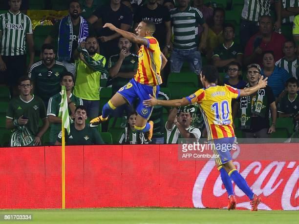 Valencia's Spanish forward Rodri celebrates after scoring a goal with Valencia's Spanish midfielder Daniel Parejo during the Spanish league football...