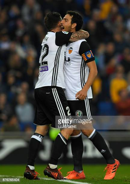 Valencia's Spanish forward Santiago Mina Lorenzo and Valencia's Spanish midfielder Daniel Parejo celebrate teammate Valencia's French midfielder...