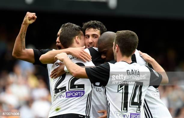 Valencia's Spanish forward Santiago Mina Lorenzo celebrates a goal with teammates during the Spanish league footbal match Valencia CF vs Club...