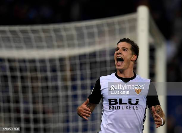 Valencia's Spanish forward Santiago Mina Lorenzo celebrates a goal during the Spanish league football match RCD Espanyol vs Valencia CF at the RCDE...