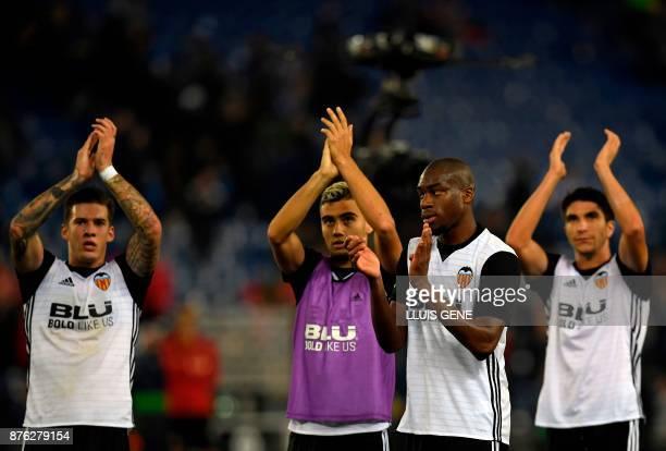 Valencia's Spanish forward Santiago Mina Lorenzo Valencia's Brazilian forward Andreas Pereira Valencia's French midfielder Geoffrey Kondogbia and...
