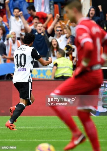 Valencia's Spanish midfielder Dani Parejo celebrates a goal during the Spanish league footbal match Valencia CF vs Club Deportivo Leganes SAD at the...