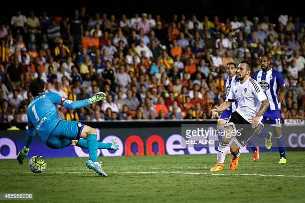 Valencia's Spanish midfielder Daniel Parejo vies with Deportivo's Spanish goalkeeper German Lux during the Spanish league football match Valencia CF...