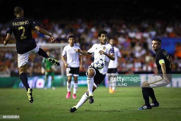 Valencia's Spanish midfielder Daniel Parejo vies with Monaco's Brazilian defender Fabinho Tavares during the UEFA Champions League playoff football...