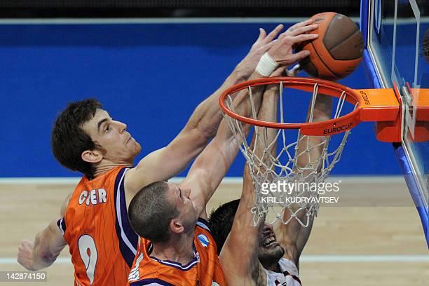 Valencia's Victor Claver and Nik CanerMedley vies with Vilnius Lietuvos Rytas's Predrag Samardziski during an Eurocup semifinal basketball match...