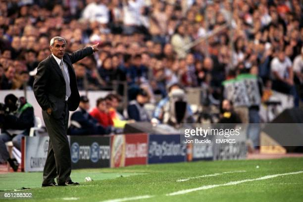 Valenciav coach Hector Cuper directs his team from the sidelines
