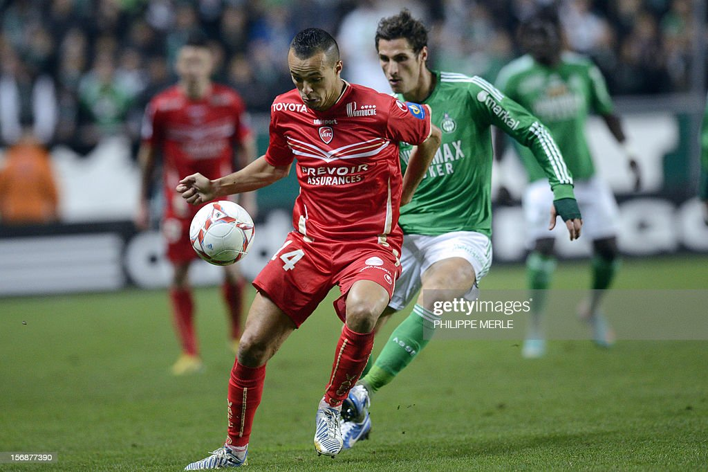 Valenciennes' Algerian midfielder Foued Kadir (L) fights for the ball with Saint-Etienne's French midfielder Jeremy Clement during the French L1 football match Saint-Etienne vs Valenciennes, on November 23, 2012 at the Geoffroy-Guichard stadium in Saint-Etienne.
