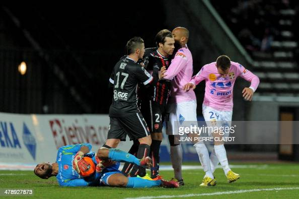 Valenciennes' Brazilian goalkeeper Novaes Magno reacts after falling onto the pitch during the French L1 football match EvianThonon vs Valenciennes...