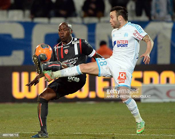 Valenciennes' Centrafrican defender EnzaYamissi Eloge vies with Marseille's French midfielder Mathieu Valbuena during a French L1 football match...