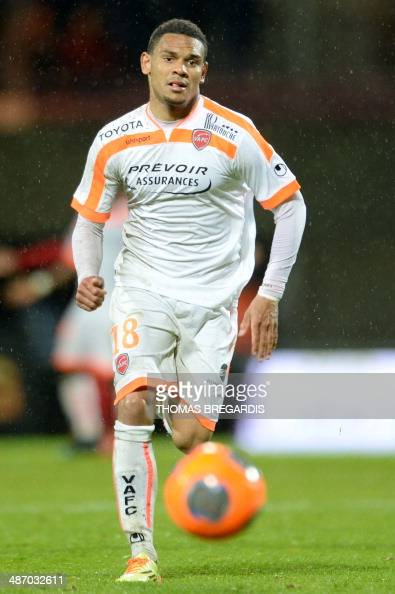 Valenciennes' defender Kenny Lala runs with the ball during the French L1 football match Guingamp vs Valenciennes on April 26 2014 at the Roudourou...