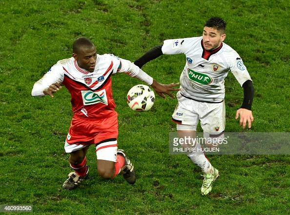 Valencienne's forward Adama Coulibaly vies with Nice's forward Neal Maupay during the French Cup football match Valenciennes vs Nice on January 3...