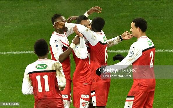 Valencienne's forward Rydell Poepon is congratuled by his teammates after scoring a goal during the French Cup football match Valenciennes vs Nice on...