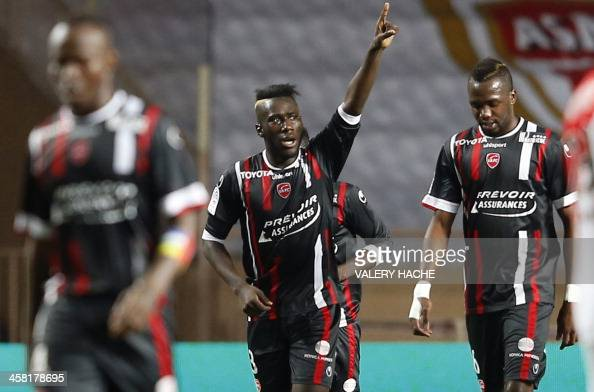 Valenciennes' French defender Fuka Arthur Masuaku celebrates with teammates after scoring a goal during the French L1 football match between Monaco...