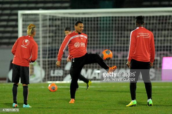 Valenciennes' French defender Kenny Lala warms up with teammates prior to the French L1 football match EvianThonon vs Valenciennes at the Parc des...