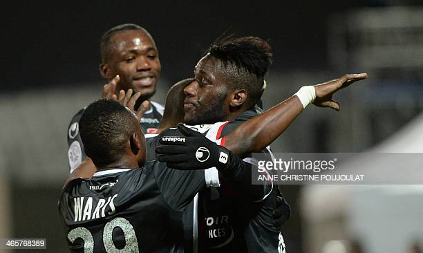 Valenciennes' French defender Masuaku Arthur is congratulated by teammates after scoring a goal during a French L1 football match between Olympique...