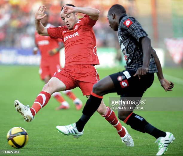 Valenciennes' French forward Gael Danic vies with Nice's Malian midfielder Abdou Traore during their French L1 football match Valenciennes vs Nice on...
