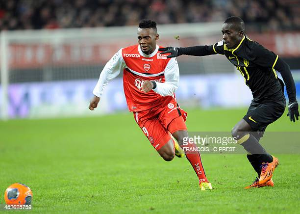 Valenciennes' French forward JeanChristophe Bahebeck vies for the ball with Lille's Senegalese midfielder Idrissa Gueye during a French L1 football...